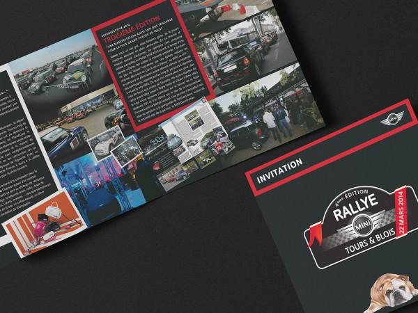 <span>Rallye Mini</span><i>→</i>
